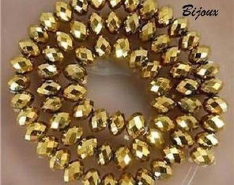 20 faceted Crystal beads gold plated 6 x 4 mm
