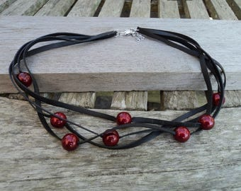 Necklace in inner tube recycled and iridescent red beads