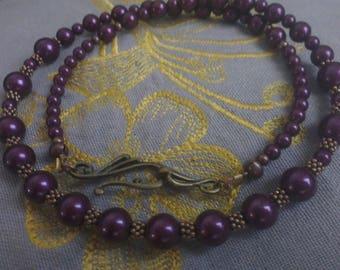 Beaded necklace round so-called Swarovski blackberry copper ring