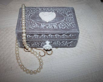 Crafted and weathered exotic wooden box