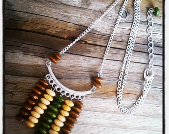 range of pendants in khaki and Brown wood beads and silver ethnic necklace
