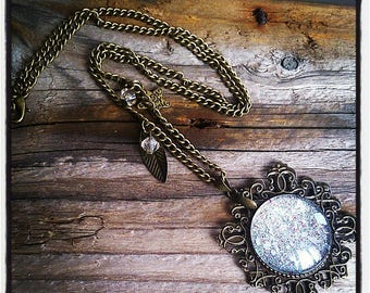 cabochon pendant necklace has glitter with silver charms