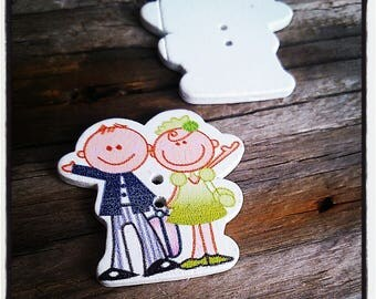 fancy 31x29mm wooden button in black and white groom and bride in green