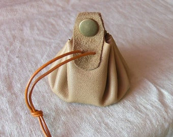 Coin purse is handmade beige leather