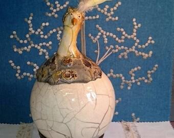 Chicken ceramic raku, backed with black smoking nitrate silver, feather headdress