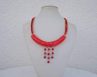 tube necklace in shades of orange and Red called polymer clay