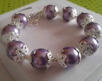 Purple pearl bracelet and silver cups
