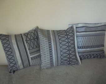 Set of three covers for cushion colors: black, gray, and silver and ecru.