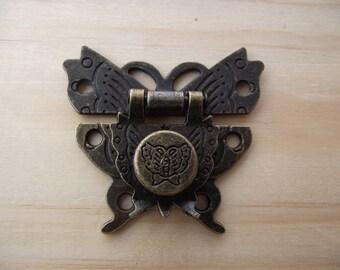 1 suitcase lock, antique bronze butterfly. 5.1 cm x 4.6 cm