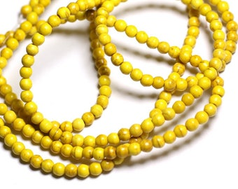 40pc - synthetic Turquoise beads 4mm yellow 4558550022547 balls