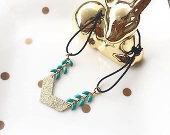 Ethnic turquoise and gold elastic bracelet with chevron