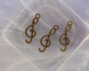 Treble clef bronze charm