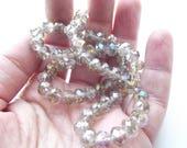 62 rondelles de cristal facetté  8 x 6 mm beige STAR-154