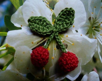 a pair of Red cherries in 3D crochet