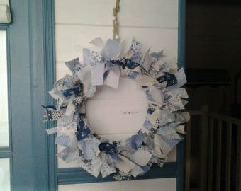 Gorgeous straw decorated in blue fabric wreath