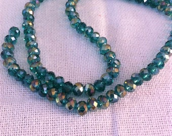 10 Crystal faceted beads green round 6 x 8 mm