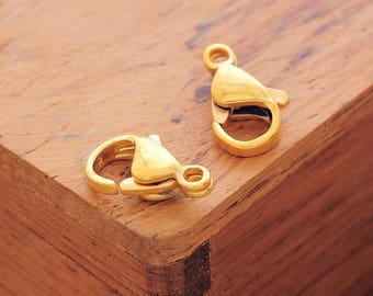 50 lobster, 12 x 7 mm, antique gold color clasps