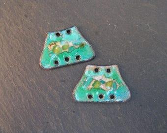 charms in enamelled copper (hot), blue, green, beige