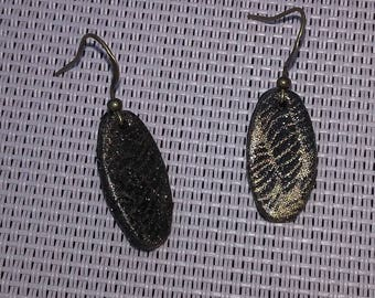 Pair of black and gold earrings