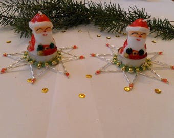 candles from the color red green Christmas table