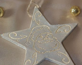 Hanging in engraved wood Christmas star