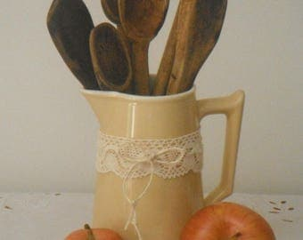 Old glazed earthenware pot and its wooden spoons