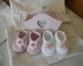 Two pairs of booties and matching basket