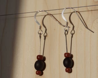 Silver earrings with canna indica and seed beads