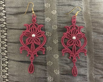 Embroidered earrings and pendant