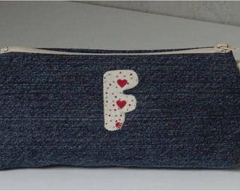 Zippered recycled denim with applied F Kit