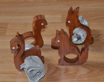 Set of four napkin rings in the shape of animals