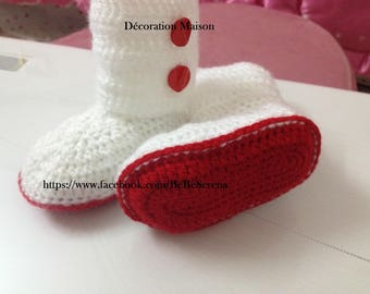 Red and white buttons with red crochet baby boots