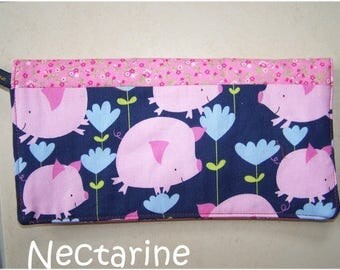Pink pig checkbook on blue background