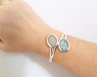 Bangle is modern, silver and turquoise, light collection,