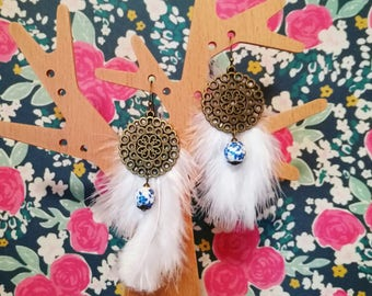 White feathers and bronze earrings