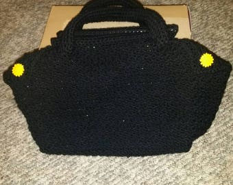 Crocheted black tote/handbag with floral lining and dowel reinforced handles