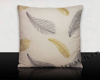 Square cushion embroidered feathers yellow/gray on off white background