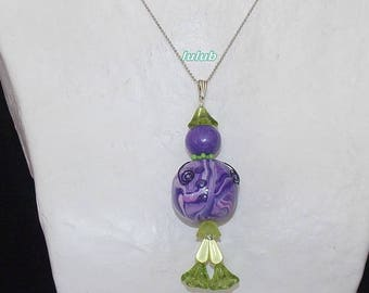 Set represent a kawaii polymer clay and its purple and green earrings