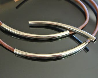 Two long tube beads curved, 80 x 5 mm to 4 mm, rhodium plated metal cord