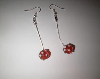 00414 - Serpentine earrings Pearl orange white polka dots.