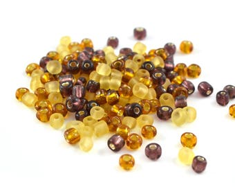 10 gr large purple glass 4mm yellow amber tone seed beads / MPERRO007