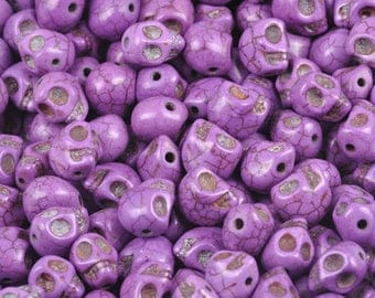 Purple skull shaped howlite bead