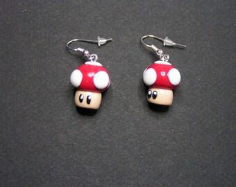 mushroom mario in polymer clay earrings