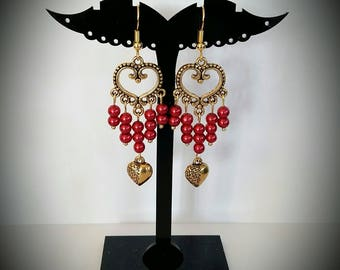 Golden red earrings and heart
