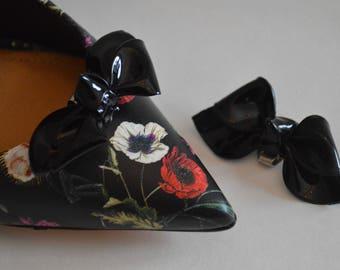 Pair of vintage black faux patent leather shoe bows