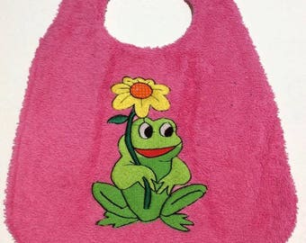 With a frog baby bib