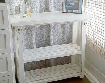 Wooden storage cart on wheels with slatted shelves