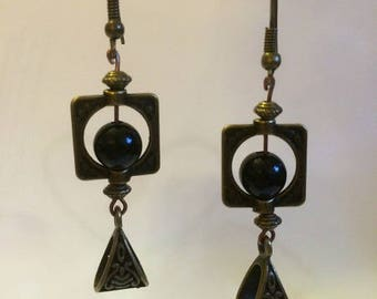 Bronze earrings with frames and black beads