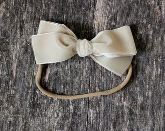 Large hand tied velvet bow for babies, toddlers and little girls in gorgeous vanilla latte. The Perfect fall neutral!