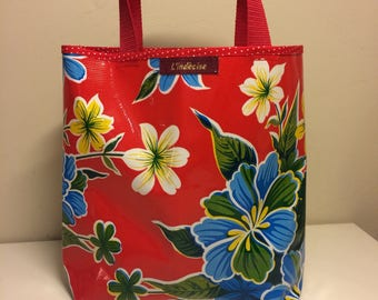 small red oilcloth tote bag